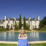 Lisa Johnson Mandell in front of California Luxury Real Estate Home